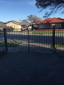 Driveway Gate with Swing Arms by Reliance Fencing Adelaide