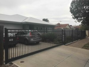 Custom Flat Rail Sliding Driveway gate and front fencing by Reliance Fencing in Adelaide by Reliance Fencing Adelaide