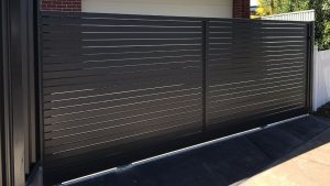 Horizontal aluminum slat sliding gate at Clearview by Reliance Fencing in Adelaide Horizontal aluminum slat sliding gate at Clearview by Reliance Fencing in Adelaide