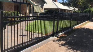 Sliding Gate at Woodville. Concrete footing, panels and sliding gate by Reliance Fencing Adelaide