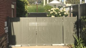 Vertical Slat Driveway gate with automation in Hawthorn by Reliance Fencing Adelaide