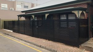 Black horizontal Aluminium at Norwood. Sliding gate completed with FAAC automation.