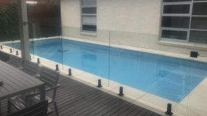 Glass Pool Fencing with Black Spigots