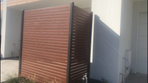 Privacy screen At Christies Beach. Wood look slats with powder coated colour posts